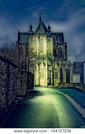 The street leading to the church in Belgium. Cathedral of St. Hubert in Belgium at Night