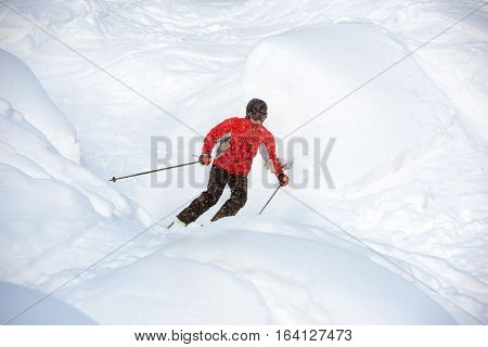 Young skier on off-piste slope. Backcountry or freeride skiing
