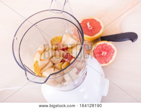 Top View Of Open Blender With Fruits