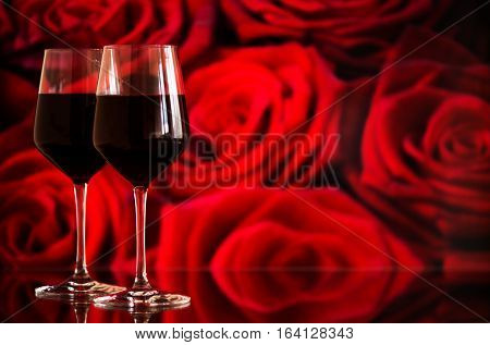 Two Glasses Of Red Wine Against Bokeh Background With Sparkles A