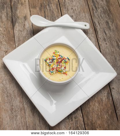 banana pudding with sprinkle close up on wood