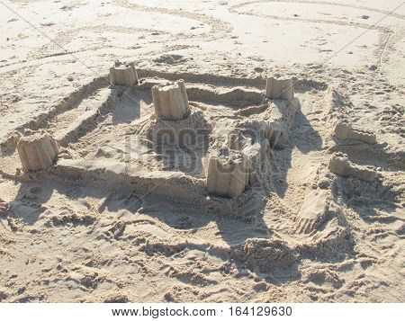 The Children Have Created A Castle Strong In Sand On The Sand During The Holidays At The Sea