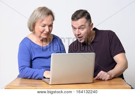 Enthusiastic Man Looking At Laptop With Woman