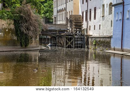 Czech Republic Prague . Kampa Island also known as Venice of Prague in the Mala Strana the old houses are reflected in the narrow river Devil (Czertovka). The old watermill .