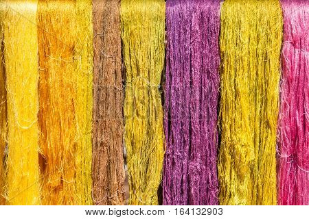 Silk industrial Colorful of silk threads hanging before weaving process.