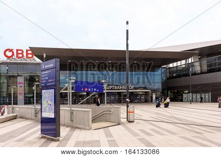 VIENNA, AUSTRIA - MAY 18, 2016: Facade of the main railway station of wien with OBB logo company, information board and people
