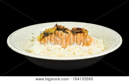 Delicious Piece Of Salmon On A Bed Of Long Grained Rice, In A Deep Plate Towards Black