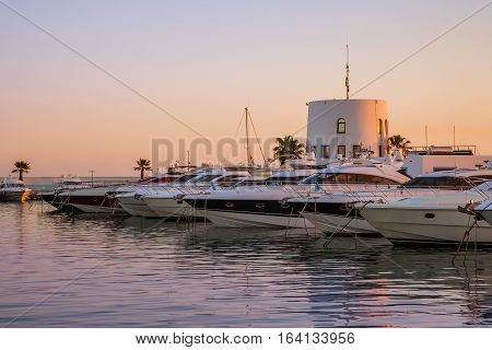 Yachts and powerboats moored in the marina in the evening sun light