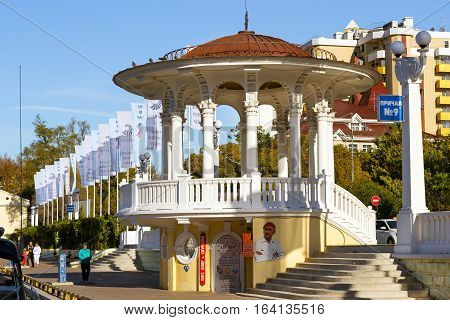 Sochi Russia - November 1 2015: Rotunda on embankment in Sochi seaport. Architecture of black sea resort city. Marine station complex Port. Krasnodarskiy kray Russia