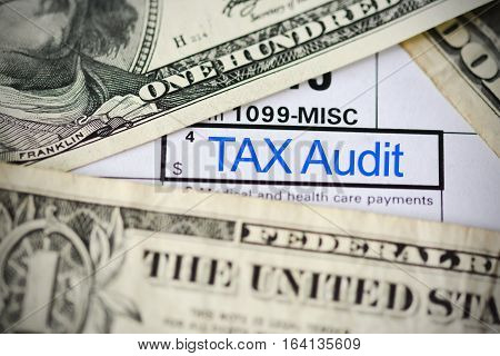 US dollar bills on tax form suggesting tax payment or audit