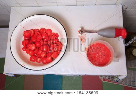 Basin With Sliced Tomatoes, A Blender And A Cup Of Tomato Sauce. Cooking Homemade Tomato Sauce In Th