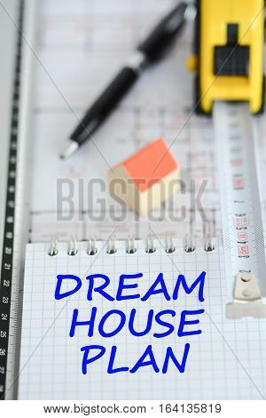 Dream house planning with architecture plan, small model house, pen and ruler