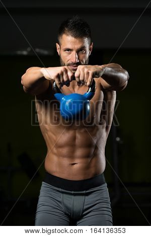 Shoulder Exercise With Kettle-bell In A Gym