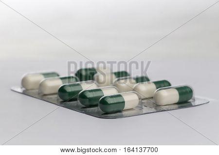 Pills in blister pack on white background.
