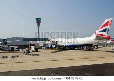 LONDON UK - JUNE 9 2016: A British Airways jumbo jet at a stand at London Heathrow Airport Terminal 5 on a sunny Summer morning.