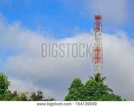 Antenna and cellular tower in blue sky background