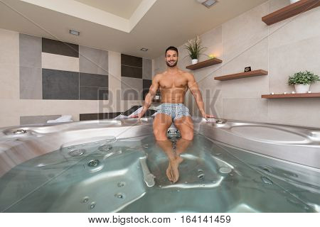 Guy Lying In Azure Jacuzzi