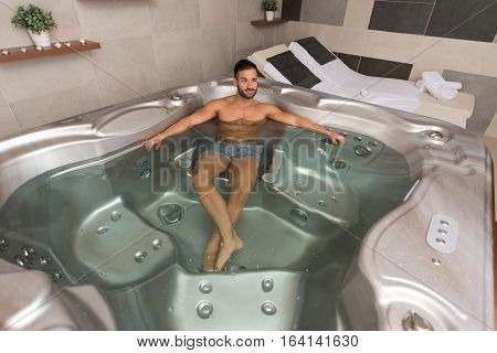 Handsome Relaxed Man In Jacuzzi Spa