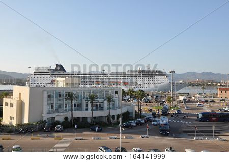 OLBIA , Sardinia , Italy - August 25, 2016 : MSC CRUSE  ferry navigating between the island of  EUROPE