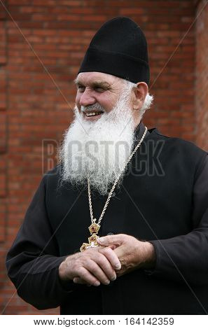 LUTSK, UKRAINE - 17 August 2012: Orthodox Christian priest with a long white beard