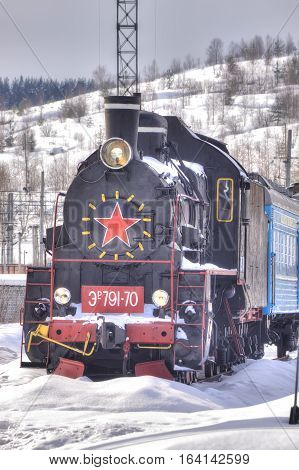 MURMANSK RUSSIA - March 27.2009: Railway station. Old steam locomotive on the siding