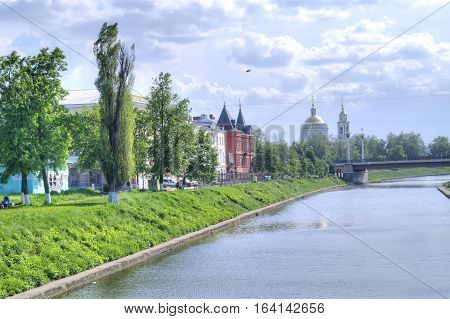 Cityscape. Old merchant houses and a temple on the shore of Orlik River in City Oryol