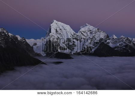 Sunset view from Gokyo Ri Everest National Park. Mount Cholatse. Sea of fog.