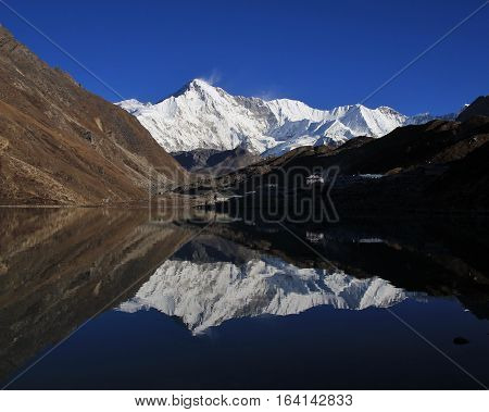 Autumn scene in the Everest National Park Nepal. High mountain Cho Oyu reflecting in Gokyo lake.
