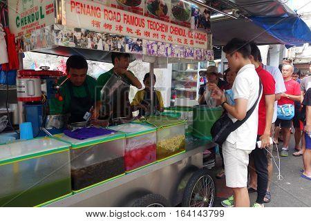 Street Hawker Sells Cendol In Penang, Malaysia