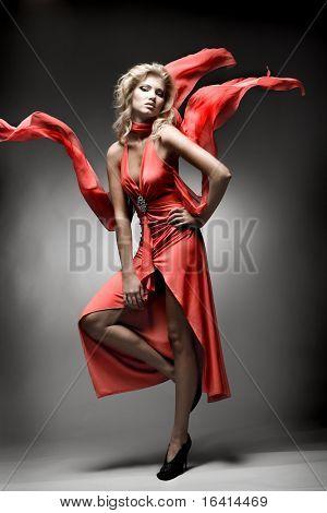 Luxury woman in red dress