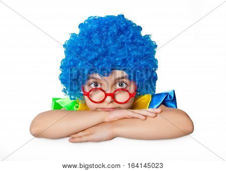 Girl in clown suit and glasses on white background