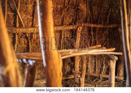 Bed in traditional tribal hut of Kenyan people Nairobi