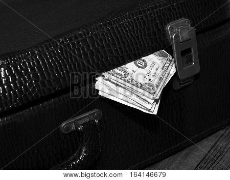 The money in the suitcase retro bag