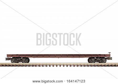 Empty railroad flat car on railway track.