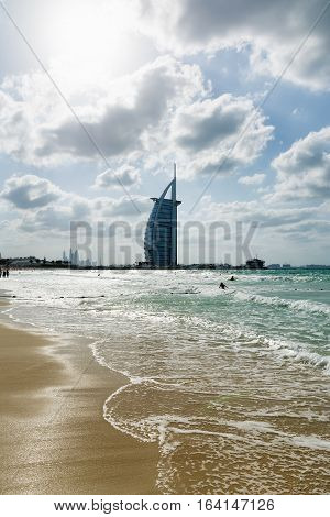 DUBAI UNITED ARAB EMIRATES - DECEMBER 9 2016: Cityscape of Burj Al Arab Hotel from Jumeirah beach. It is a luxury hotel located in Dubai United Arab Emirates the fourth tallest hotel in the world;