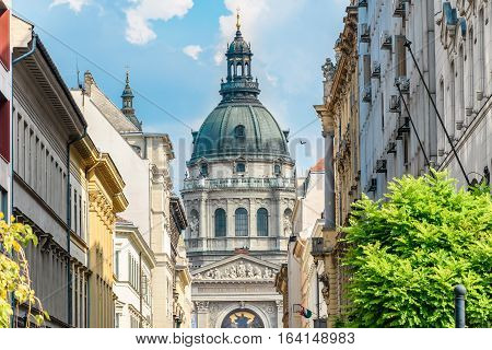 St.Stephen`s Basilica (Szent Istvan Bazilika). Blue cloudy sky. Two bell towers with the clocks. Budapest Hungary.