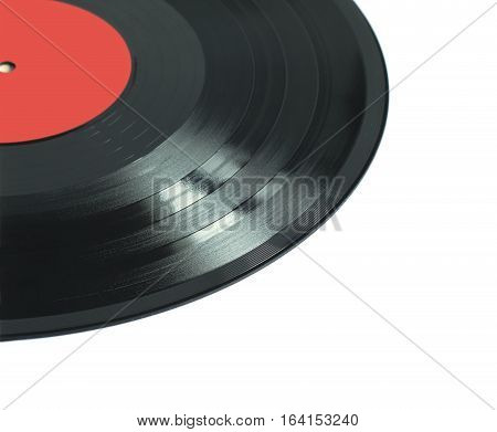 Part of black long-play vinyl record with red label isolated on white background. Photo closeup