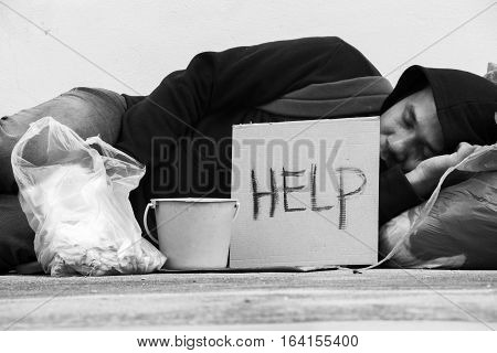 Homeless person sleep on sidewalk of the street