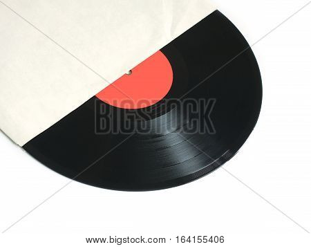 Black long-play vinyl record with red label from the paper sleeve isolated on white background. Photo closeup