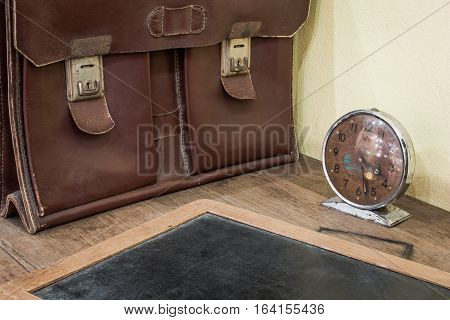 Brown Antique Schoolbag Vintage, Vintage Clock And Antique Slate On Old Wooden Desk. School In The P