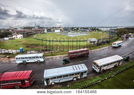 GALLE, SRI LANKA. August 01, 2016: Galle International Stadium  is a cricket stadium in Galle, Sri Lanka, situated near the Galle fort and fringed on two sides by the Indian Ocean. Aerial view with road and bus