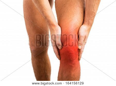 Person having a knee pain holding on to it