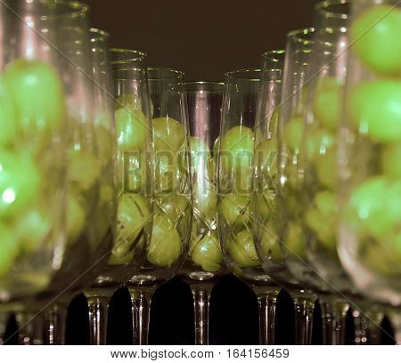 Twelve grapes in champagne glasses. Spain New Year's tradition is to eat twelve grapes at midnight, for good luck.