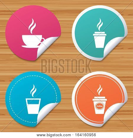 Round stickers or website banners. Coffee cup icon. Hot drinks glasses symbols. Take away or take-out tea beverage signs. Circle badges with bended corner. Vector