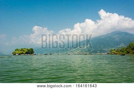 Landscape of green lake with island. Taal Barahi Temple on Lake Phewa, Pokhara in Nepal.