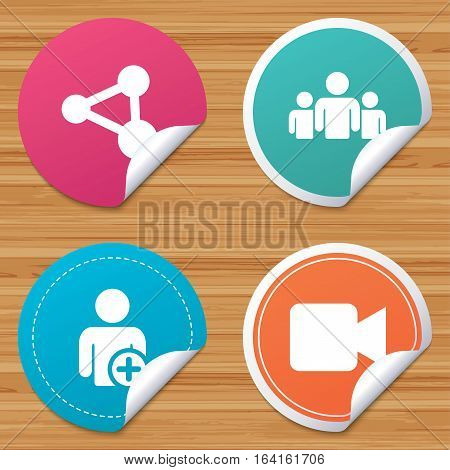 Round stickers or website banners. Group of people and share icons. Add user and video camera symbols. Communication signs. Circle badges with bended corner. Vector