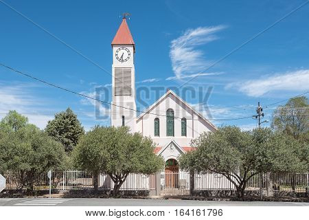 KOFFIEFONTEIN SOUTH AFRICA - DECEMBER 24 2016: The Dutch Reformed Church in Koffiefontein (coffee fountain) a diamond mining town in the Free State Province. Built 1909 with the tower added later