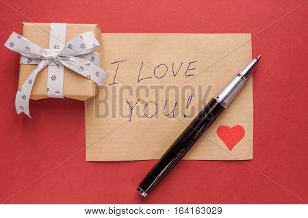 gift box pencil red heart and confession letter