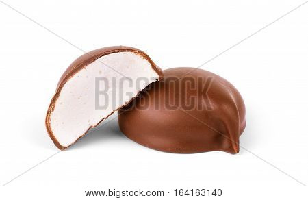 two chocolate covered marshmallows part of one bitten off isolated on white background