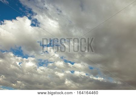 Cumulus clouds moving across a summer sky.
